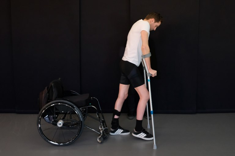 This handout photo released on October 31, 2018 by the Federal Polytechnique School of Lausanne (EPFL)/ The Lausanne University Hospital (CHUV) shows Gert-Jan Oskam, at the Lausanne University Hospital in April 2018. A breakthrough treatment involving electrical stimulation of the spine has enabled paralysed patients to walk again, apparently reactivating nerve connections and providing hope for people even years after accidents. EPFL / AFP