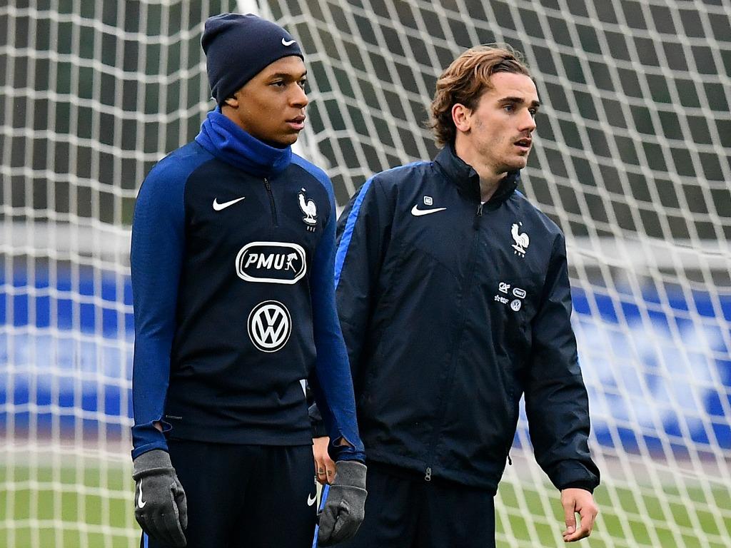 Kylian Mbappé (à gauche) et Antoine Griezmann